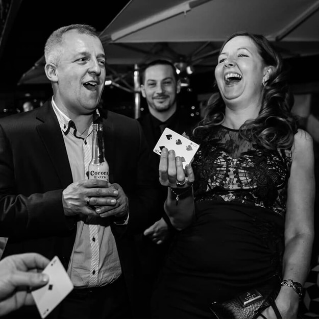 corporate magician sam fitton performs magic to guests at corporate event in manchester